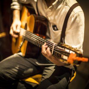acoustic guitar player at kaname bar