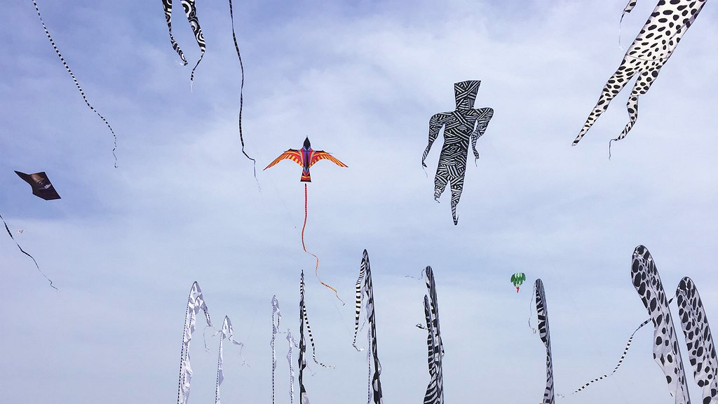 Kites in the sky at the Peaceful World Kite Festival in Uchinada, Japan