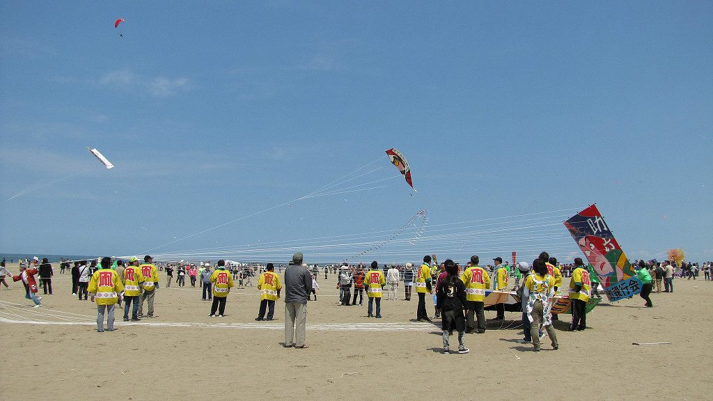 Preparing to launch massive kites at Uchinada's Peaceful World Kite Festival
