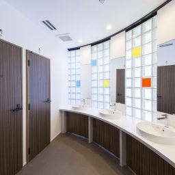 sinks and showers in kaname backpacker's hostel guesthouse