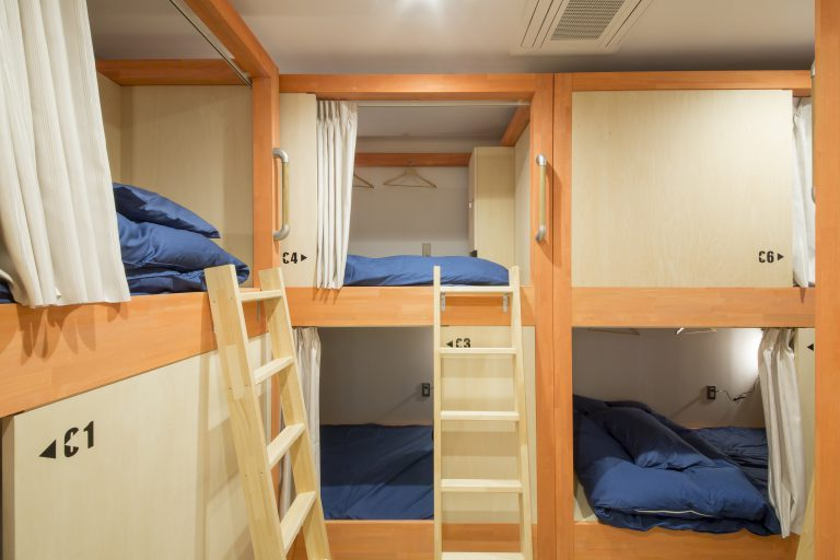 roomier than a capsule hotel, large beds at hostel in Kanazawa