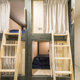 semi double bed bunks with privacy curtains and lights in kaname hostel, backpacker's resthouse