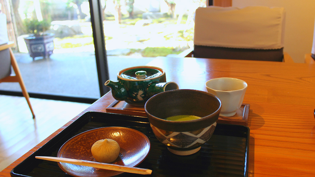 Matcha green tea, houjicha, and traditional wagashi Japanese sweet in geisha district cafe