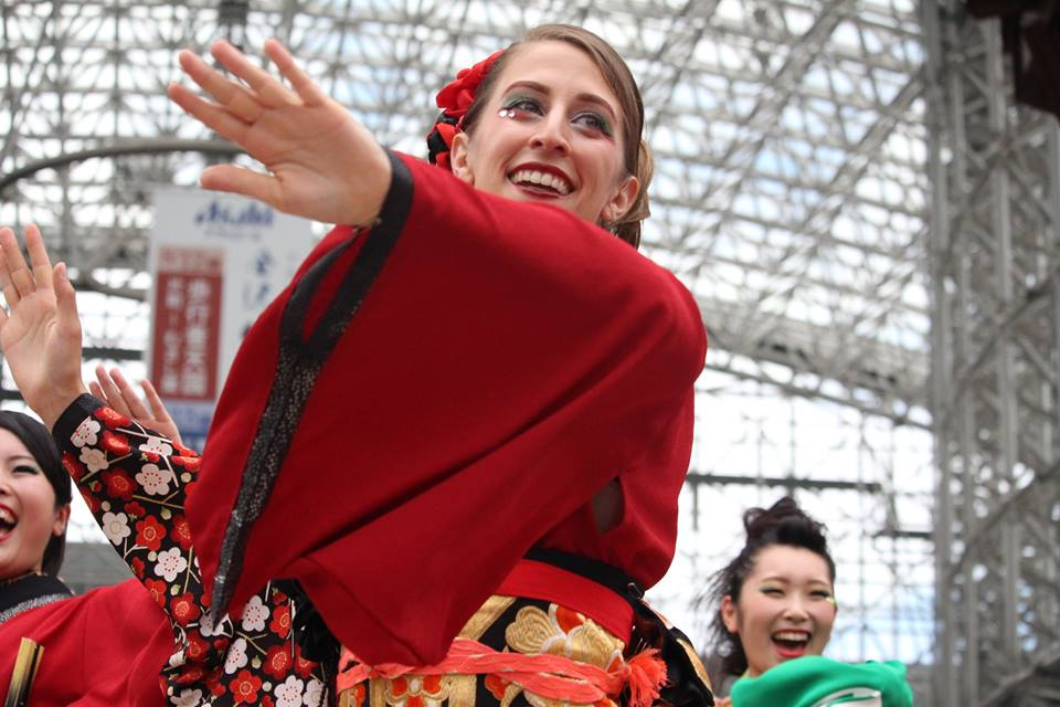Sarah performing yosakoi with her team at Kanazawa Station, by Tamaya Greenlee