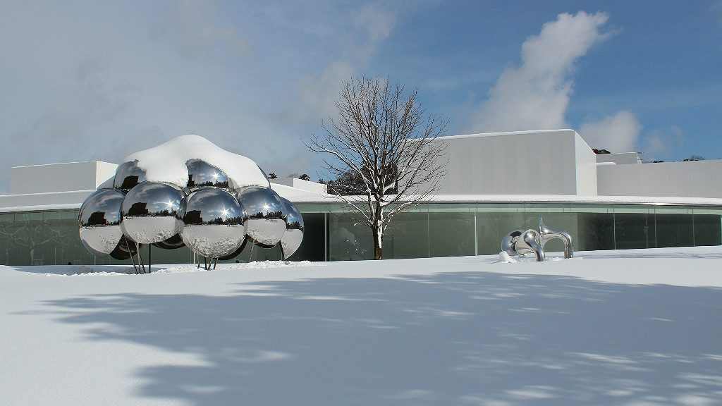 The 21st Century Museum of Contemporary Art with Outdoor Exhibitions in snow, Kanazawa winter