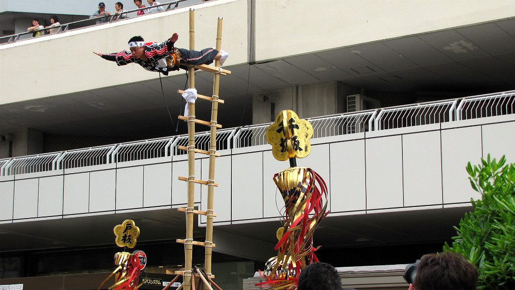 Kaga Firefighters show off their acrobatic skill during the Hyakumangoku Festival Parade