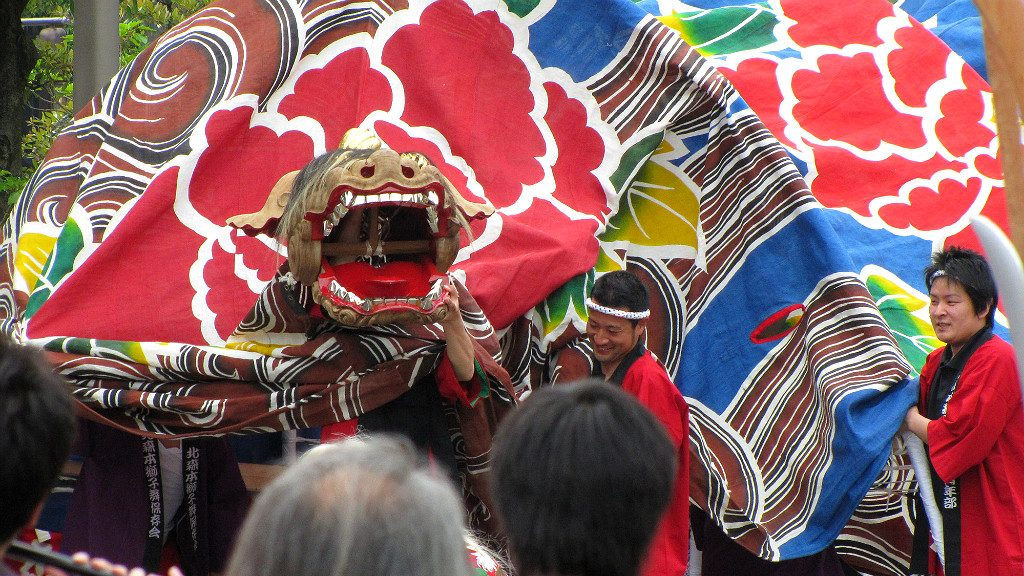 The Kaga Lion Dance Mask at the dragon's head in Kanazawa's Hyakumangoku Festival Parade