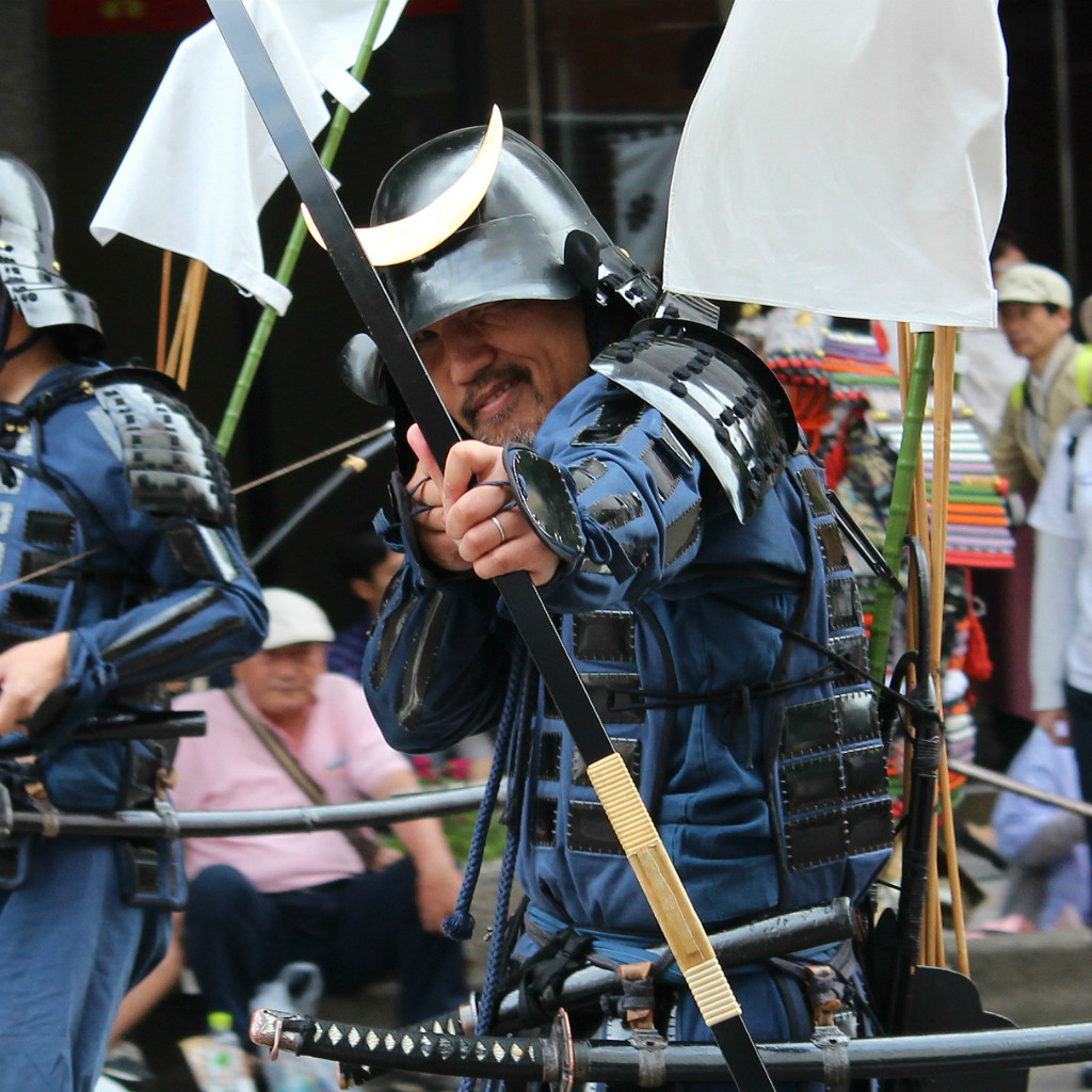 samurai feigning knocking an arrow at the Hyakumangoku Festival in Kanazawa