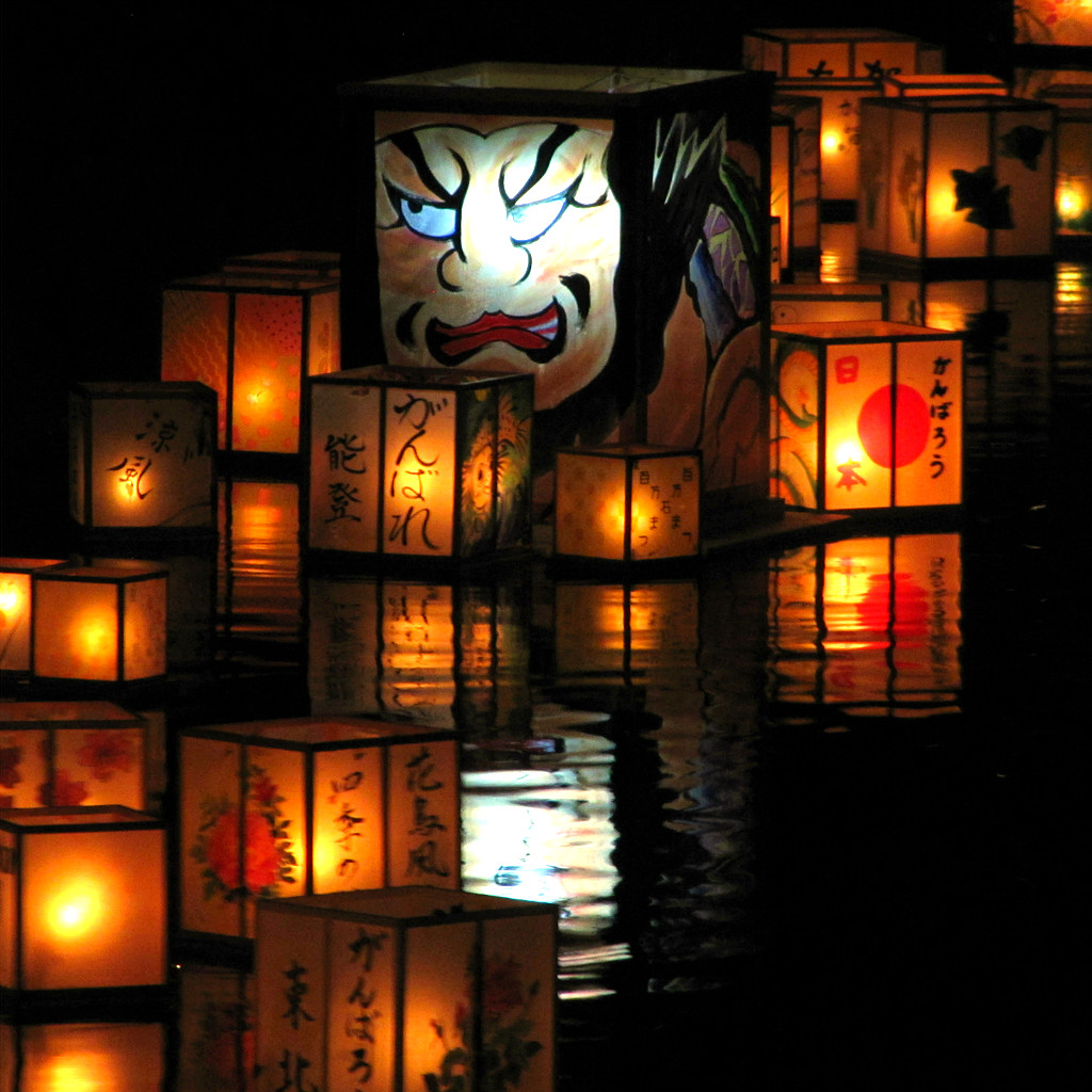 kaga yuzen lanterns float down the Asano River for Hyakumangoku Festival