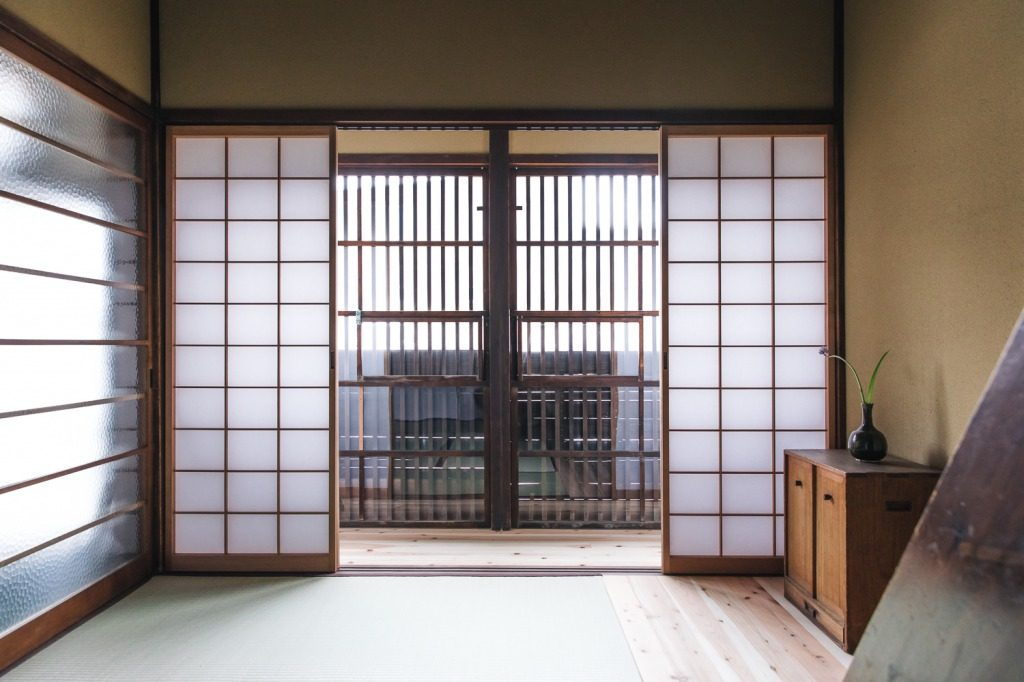 Paper windows called shoji and wood flooring are common in machiya homes