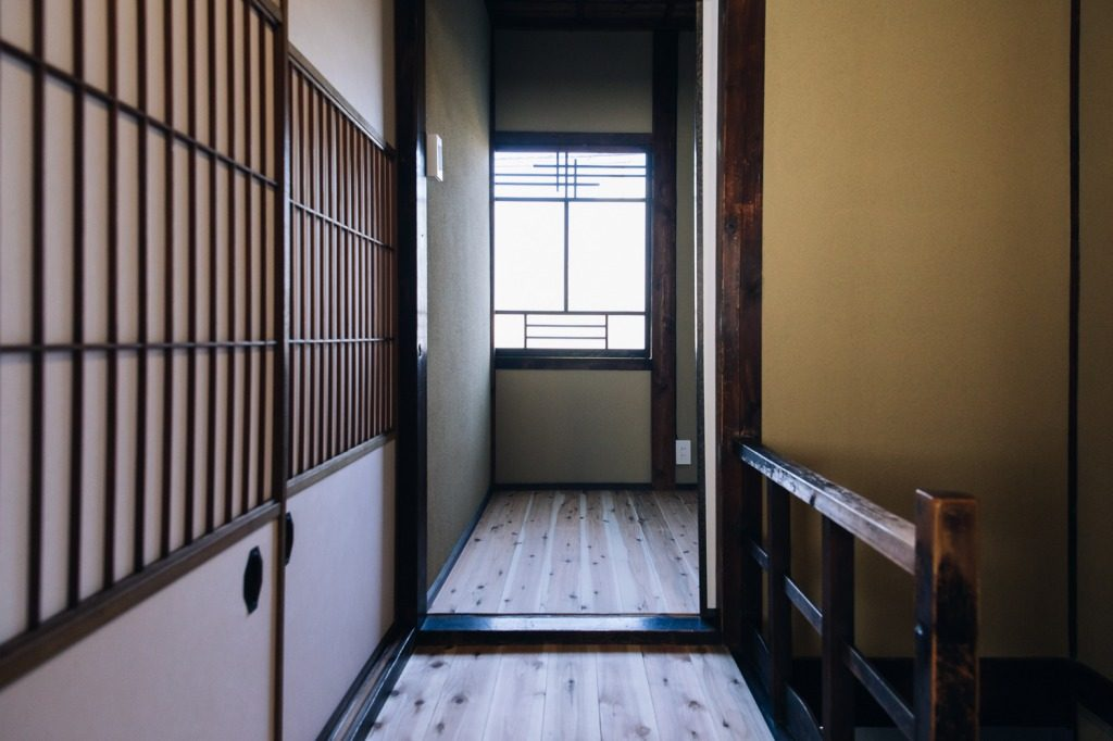 Sliding doors, wood floors, and shoji paper windows are common in traditional machiya homes in Japan