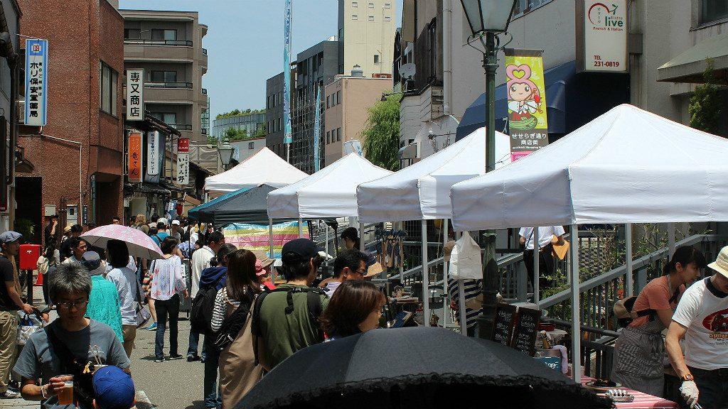 Food and flea market booths line Seseragi Street for the Marraige Festival in Kanazawa, Japan