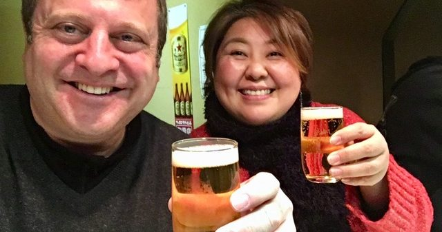 Andrew Blechman and friend Akiko sharing a beer in Kanazawa, Japan