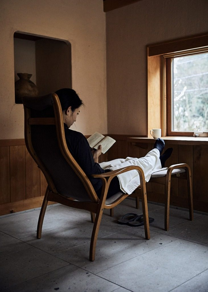 Relaxing with a book in Yuyado Sakamoto's guestroom in the Noto, north of Kanazawa, Japan