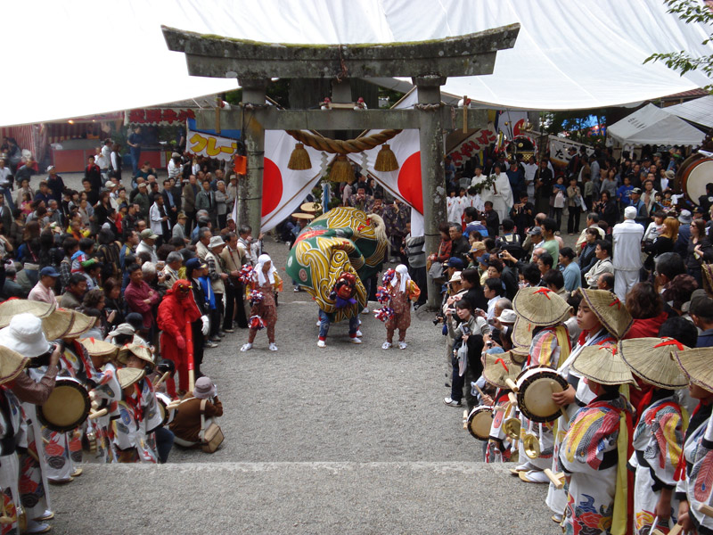 Lion dances under the torii gate during the Doburoku Festival in Shirakawago
