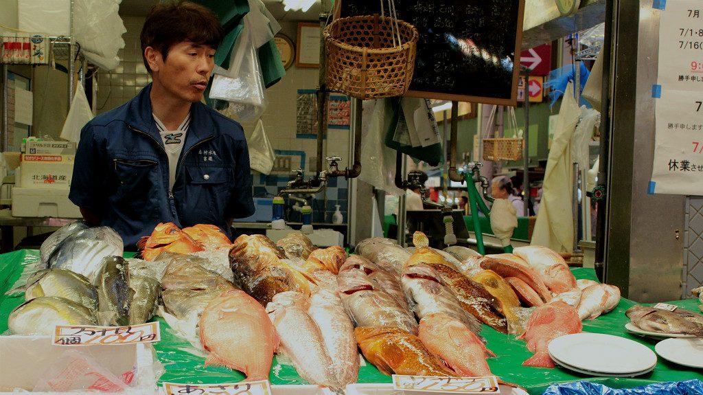 Fish seller at Omicho Market in Kanazawa, Japan