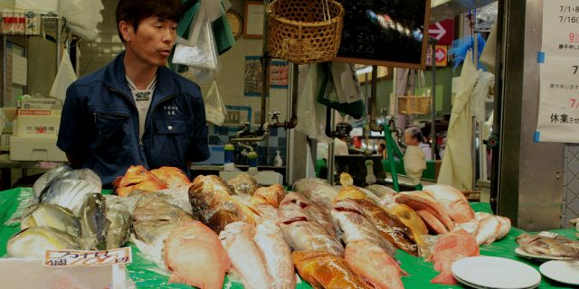 Fish seller at Omicho Market in Kanazawa, Japan