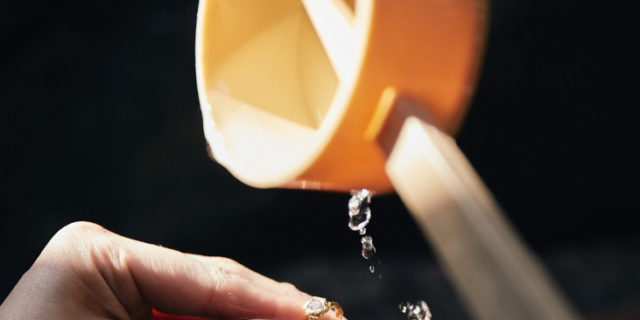 Water from the shrine at Natadera, poured over hands to purify