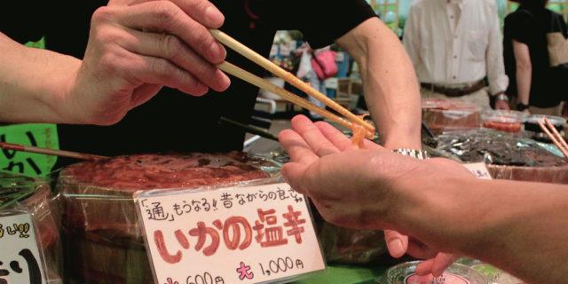 Snacking on samples in Omicho Fish Market in Kanazawa, Japan