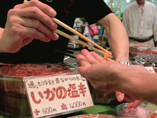 Snacking on samples in Omicho Fish Market in Kanazawa, Japan