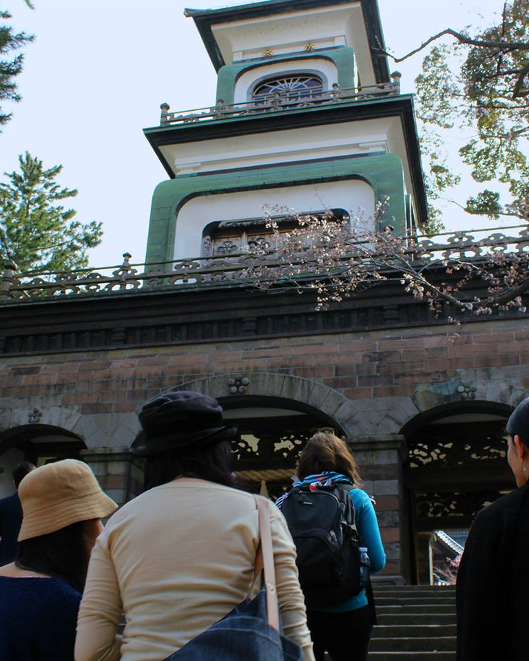Approaching the gate of Oyama Shrine with a tour group from Kaname Inn in Kanazawa, Japan