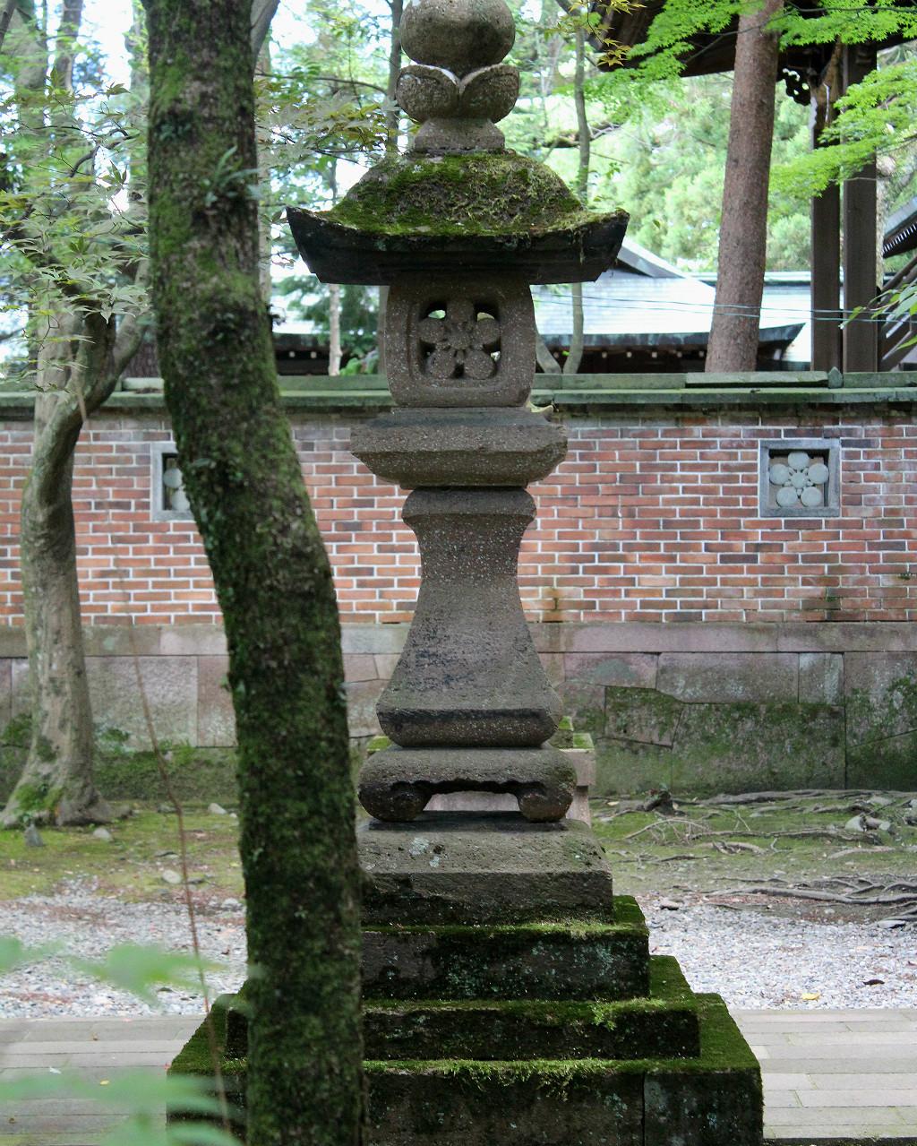 Lantern guiding the path to the secondary shrine at Oyama Shrine in Kanazawa, Japan
