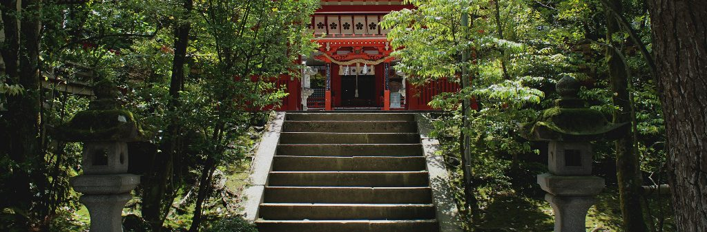The canopied stairway to the vermillion pained Kanazawa Shrine.