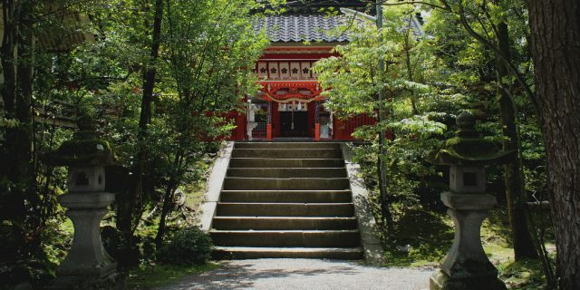 The canopied stairway to the vermillion pained Kanazawa Shrine.
