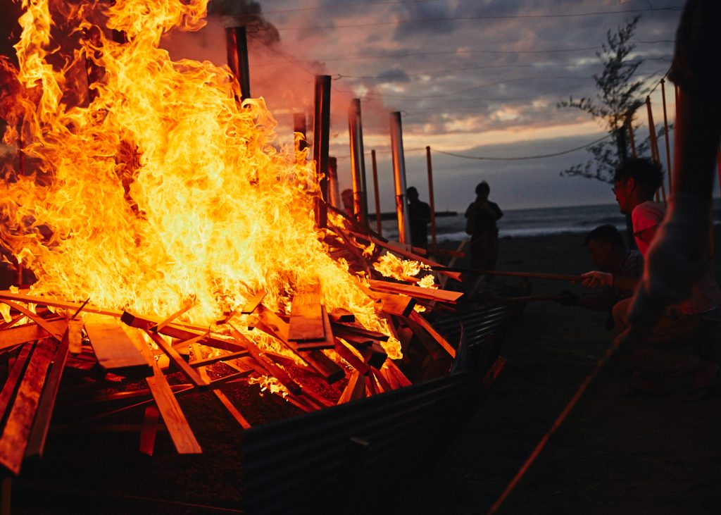 Noyaki, the wild fire kiln, turns into a bonfire after sunset.