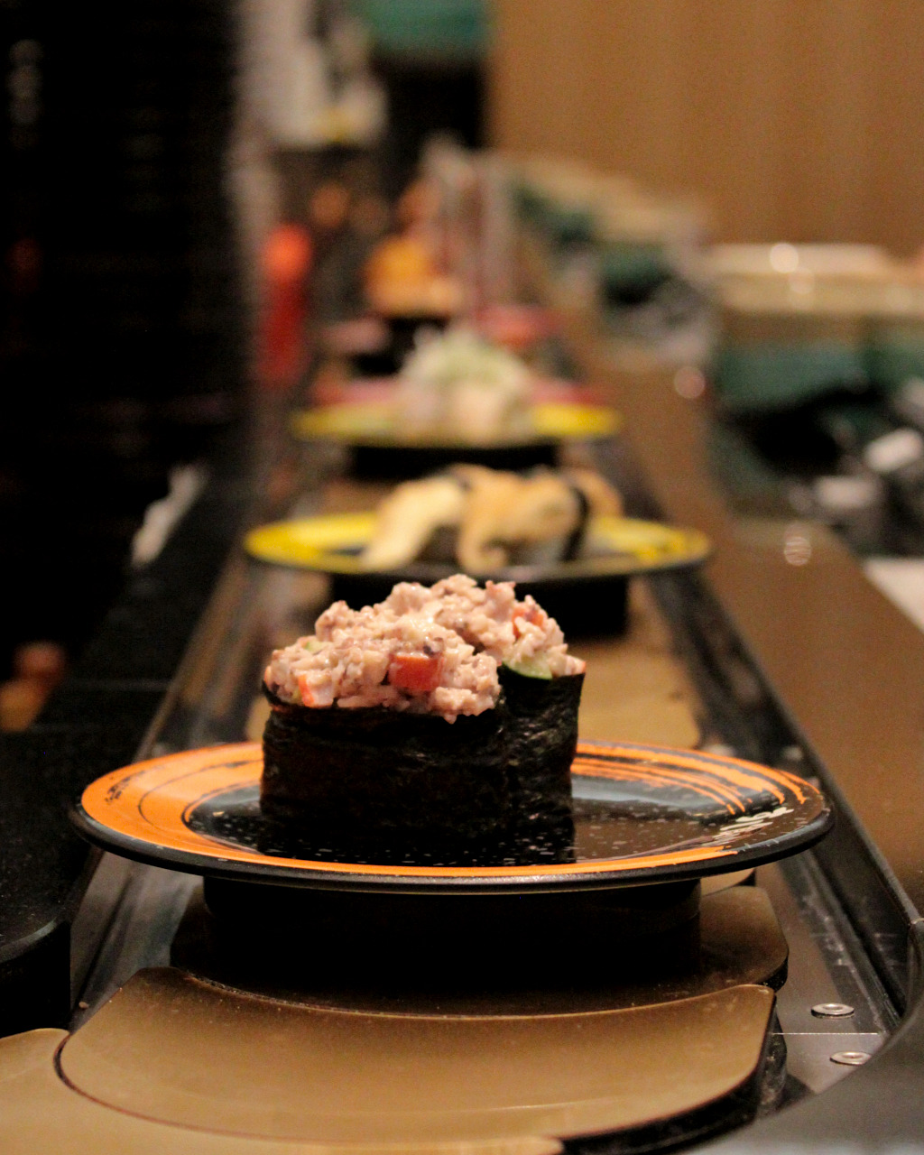 Sushi along the conveyor belt at Suishi Kuine in Kanazawa, Japan