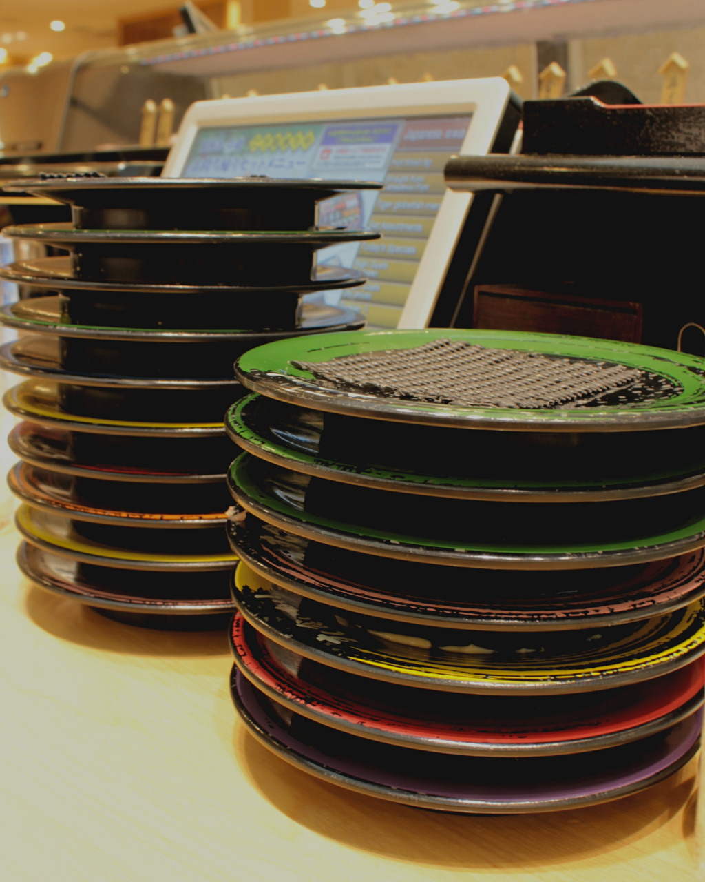 Stacks of eaten sushi at Kuine in Kanazawa, Japan