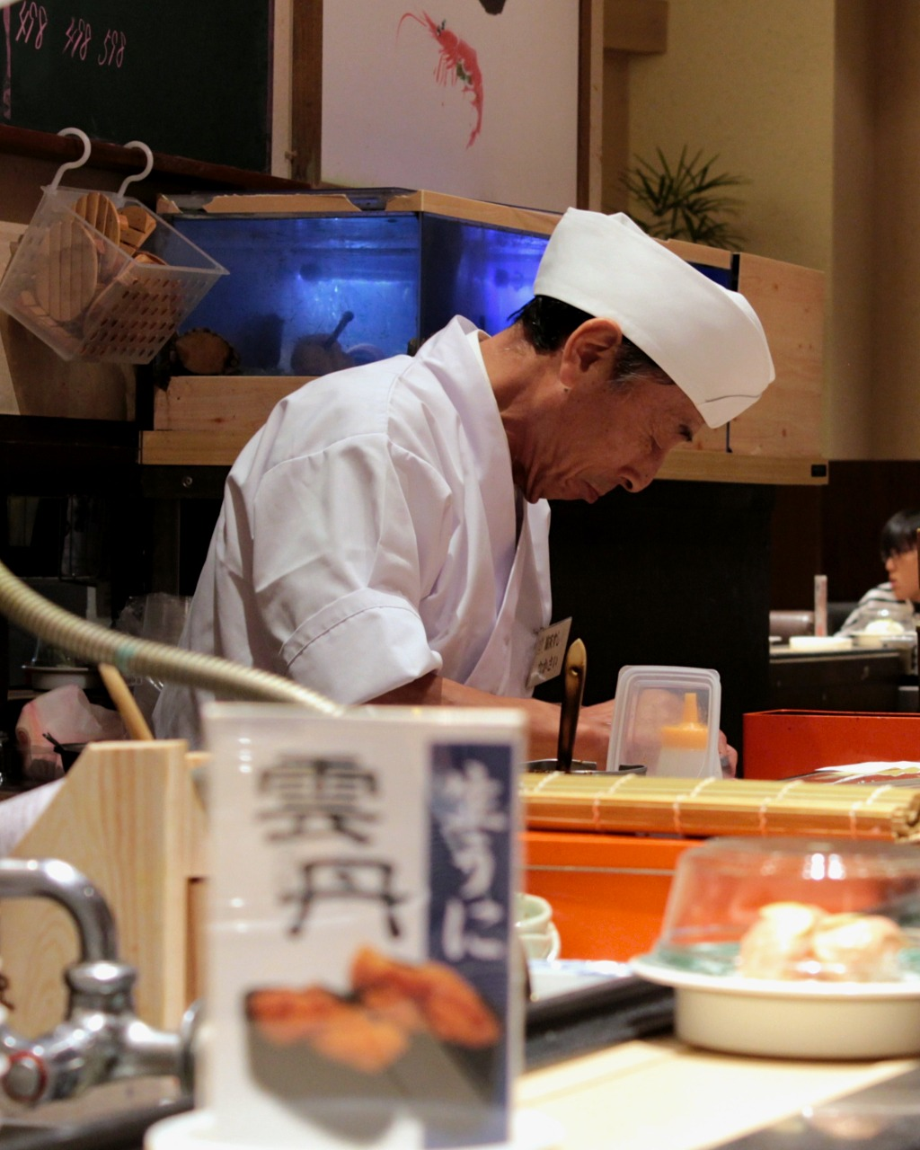 Chef at Kaiten Sushi, a sushi train chain in Kanazawa, Japan
