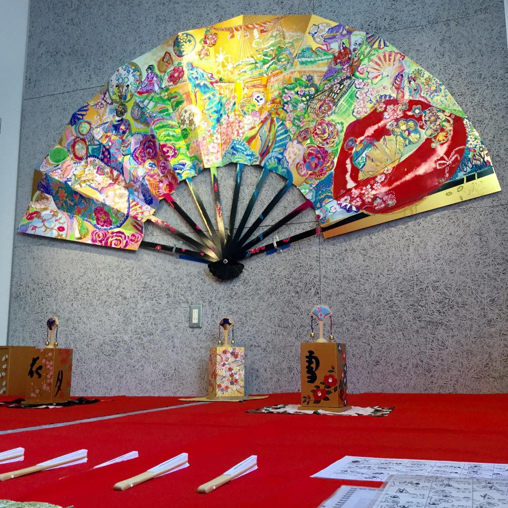 Monster fan on the wall of Kaname Hostel in Kanazawa