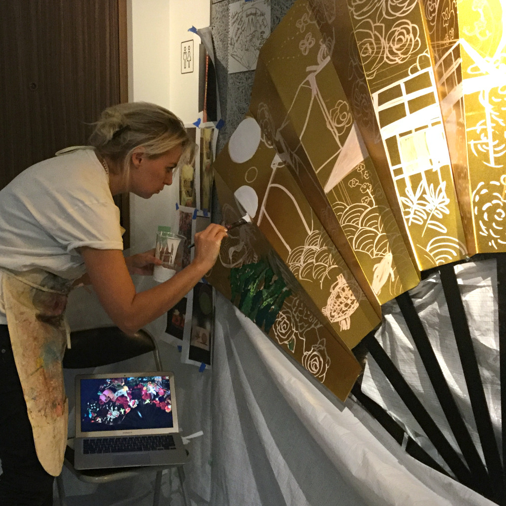 Traveling artist, Olesya at work in Kaname Hostel