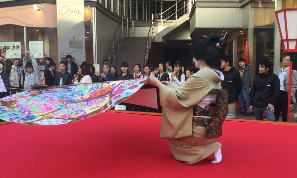 Geisha of Nishi Chaya try their hands at flying the monster folding fan