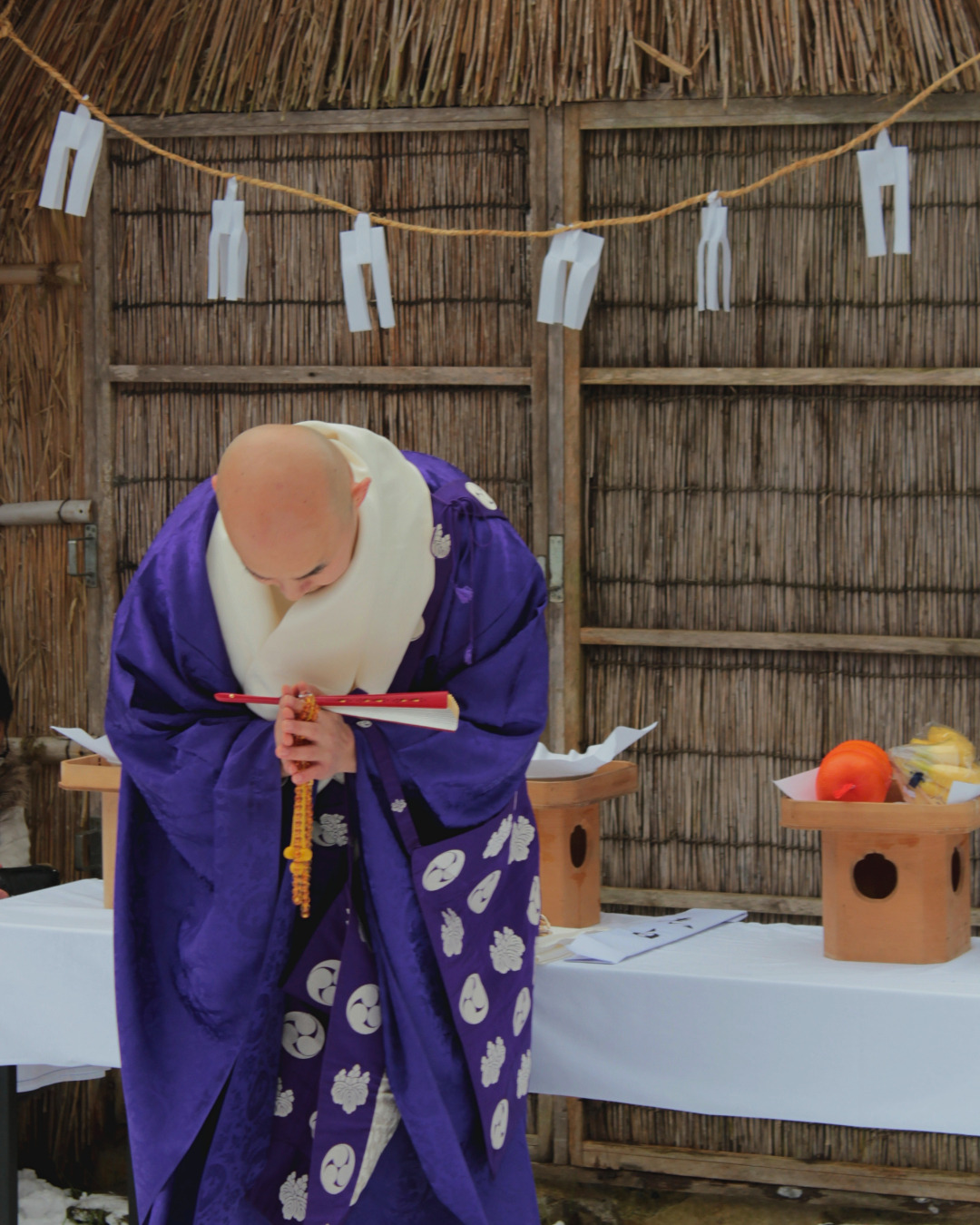Priests bring offerings to the kami—spirit—of the thatched ice house in Yuwaku Onsen, Kanazawa, Japan