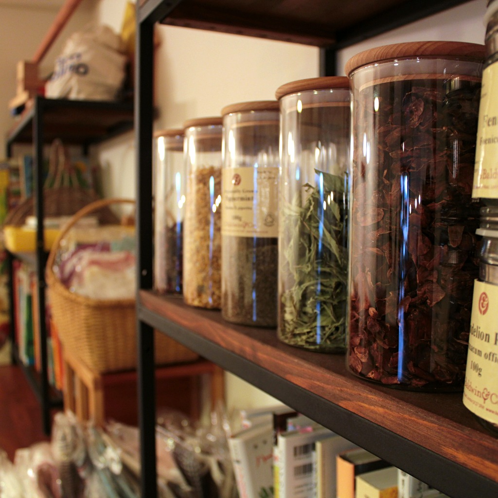 Spice racks and bookshelves in Taste & Scent, a veggie-friendly cafe in Kanazawa, Japan