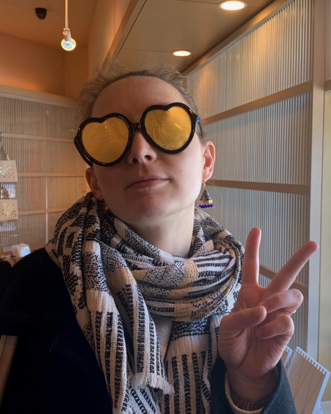 Jess wearing gold leaf glasses at Imai Kinpaku in Kanazawa