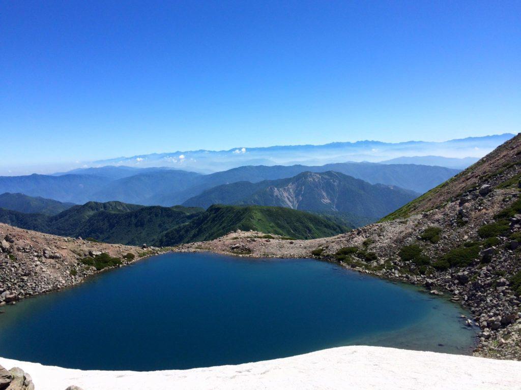 Midori-ga-Ike Lake at the top of Mount Haku on a clear day