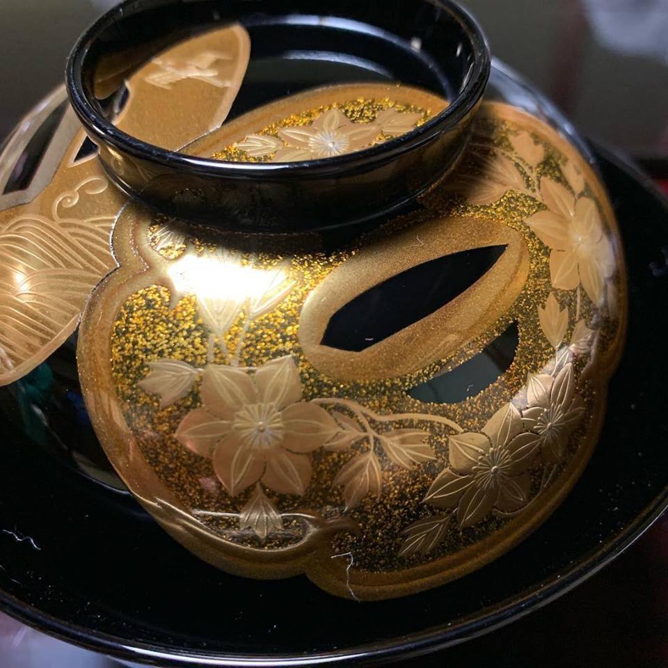 A makie lacquerware bowl decorated with tsuba, the guards of Japanese swords, at Tsubajin in Kanazawa