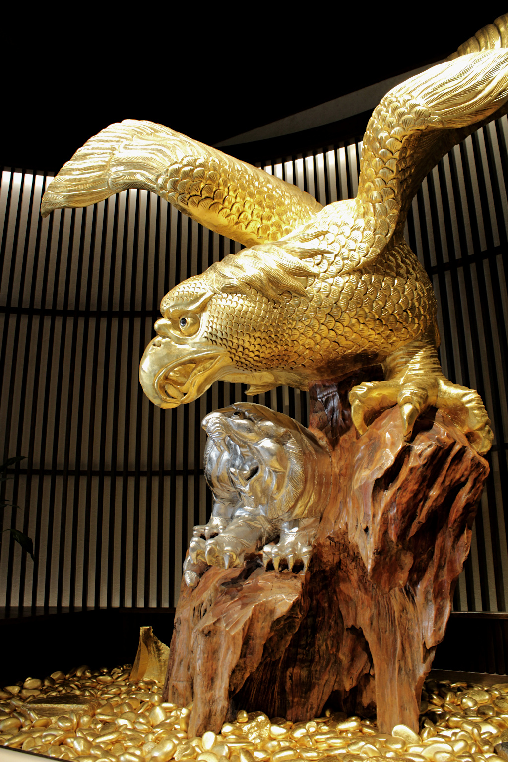 A massive wooden statue of an eagle and tiger fighting, treated with gold and silver foil application techniques of Kanazawa, a the Sakuda store in the Higashi Chaya geisha district in Kanazawa