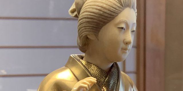gold and ivory geisha doll in the western geisha district in Kanazawa