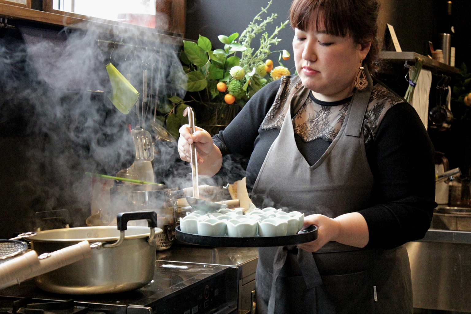 Naoko dishes out some freshly cooked fish cake dumpling soup during her cooking class in Kanazawa, Japan