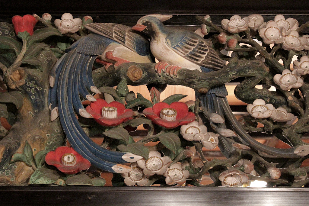 Pheasants and camellia blossoms inhabit the detailed transoms above the receiving room in Seisonkaku Villa, a small Japanese Palace in Kanazawa.