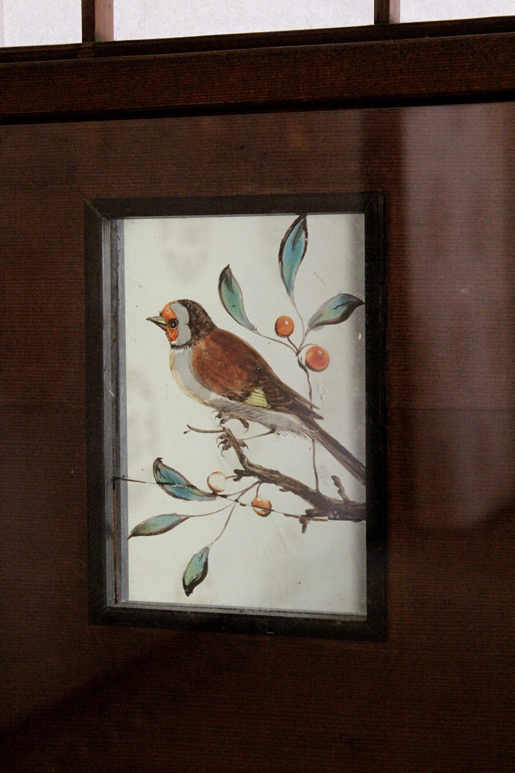 "In the ""Pine Chamber,"" a private room, the bottom panel of the sliding doors is decorated with glass panels painted with birds, imported from the Netherlands."