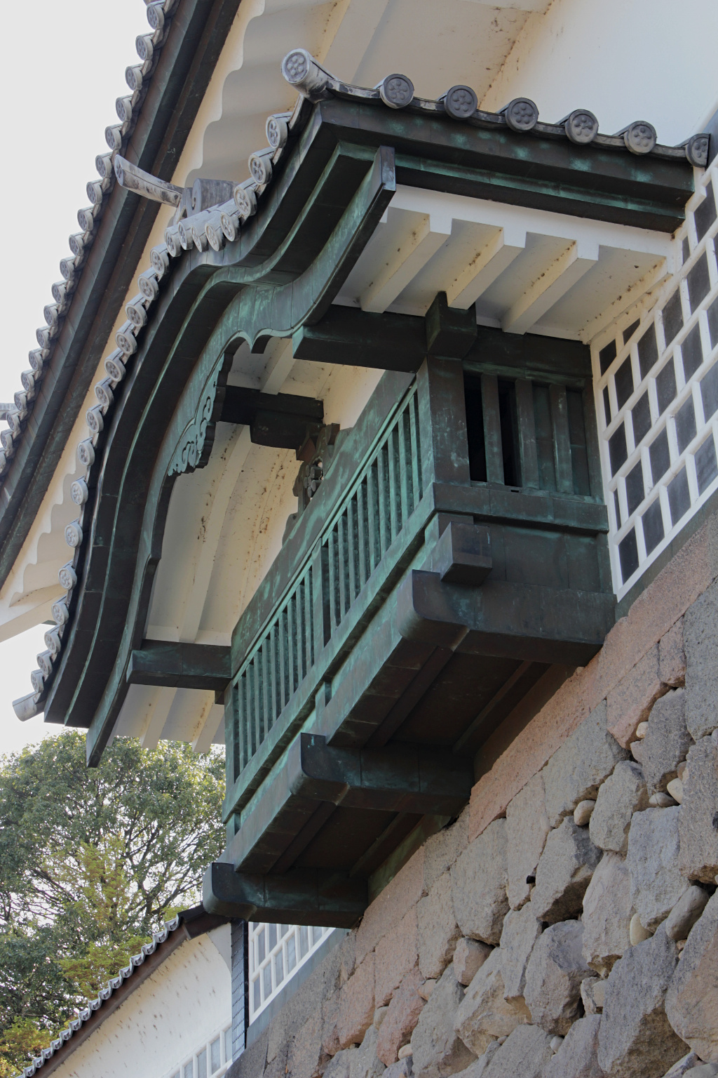 """One of the lookouts and """"murder holes"""" in Kanazawa Castle overlooking the moat."""