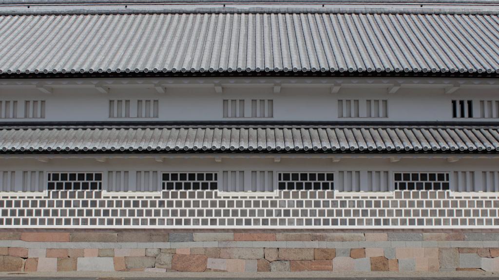 The interior walls of Kanazawa Caslte align windows symmetrically.