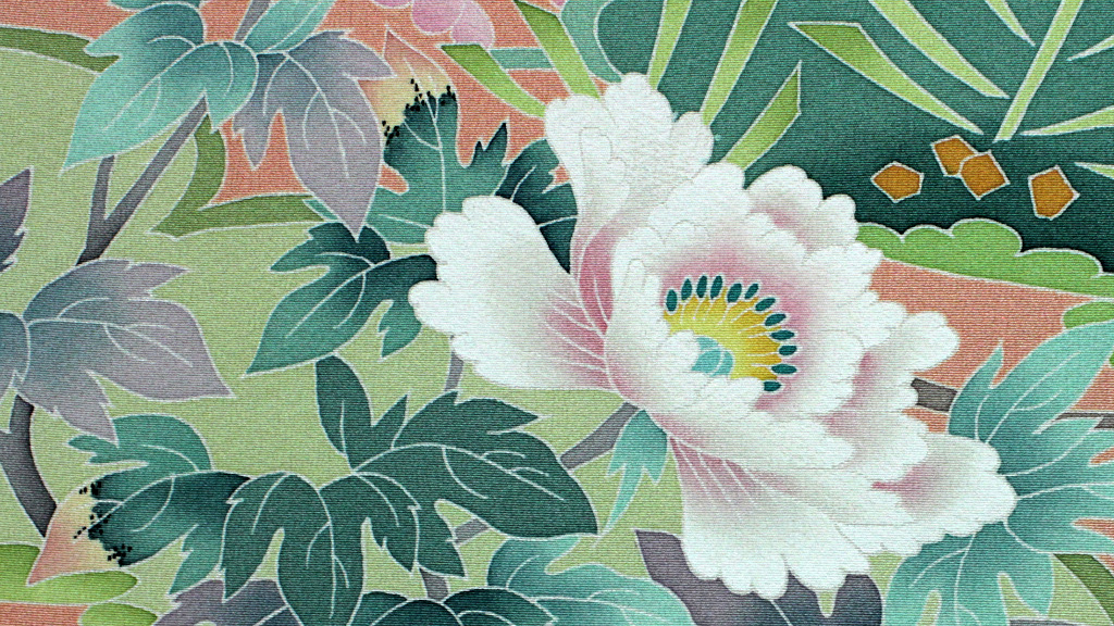 Close up of a flower and leaves painted on Kaga-yuzen silk for a kimono