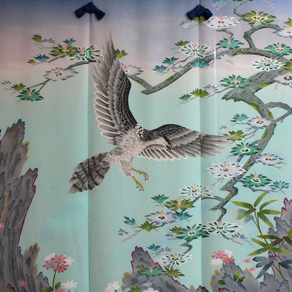 a noren, or door curtain, of Kaga-yuzen silk, painted with a hawk